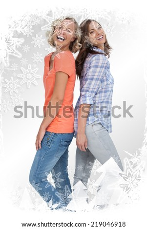 Composite image of two friends laughing against christmas frame - stock photo