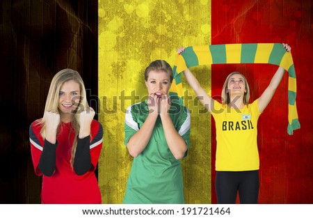 Composite image of various football fans against belgium flag in grunge effect