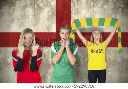 Composite image of various football fans against england flag in grunge effect
