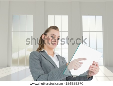Composite image of woman pressing something on the pane in bright 3d room with windows - stock photo