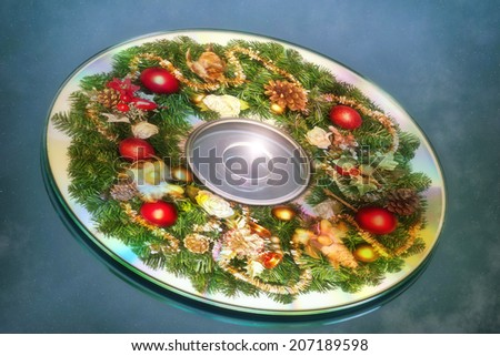 Composite of a christmas wreath and cd - stock photo