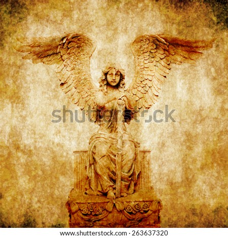 composite of angel statue and grunge background - stock photo