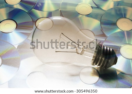 Composite of CDs and Light Bulb - stock photo