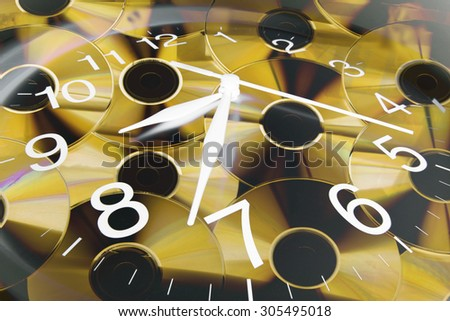 Composite of Clock and CDs - stock photo