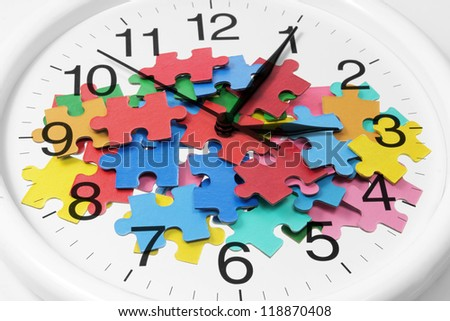 Composite of Clock and Puzzle Pieces - stock photo