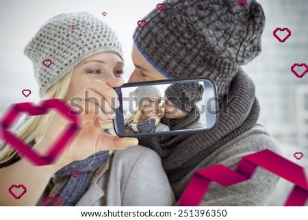 Composite of Couple taking Valentines selfie - stock photo