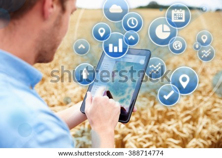 Composite Of Farmer In Field Accessing Data On Digital Tablet - stock photo