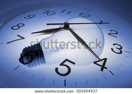 Composite of Wall Clock and Light Bulb