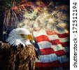 Composite photo of a Bald Eagle with a flag and fireworks in the background. Nice patriotic image for Independence Day, Memorial Day, Veterans Day and Presidents Day. - stock photo