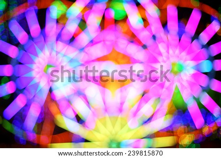 Composite picture of ferris wheel blur and bokeh abstract - stock photo