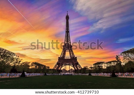 Composite timelapse image of sunset clouds at the Eiffel tower in spring in Paris, France - stock photo