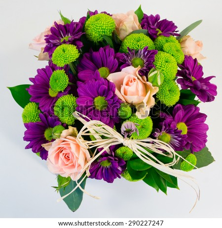 Composition. Box of light pink roses and chrysanthemum
