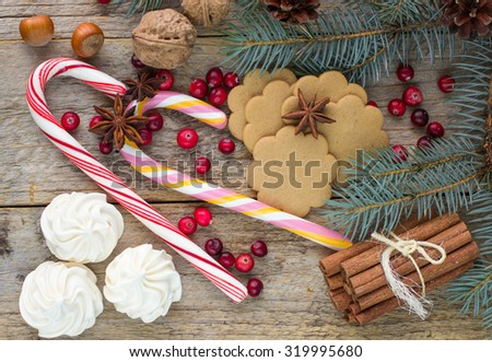 Composition for Christmas and New year -   walnuts, hazelnuts, candies, meringue, cookies, cranberry, cinnamon and star anise. Spices, sweets and nuts. Christmas background