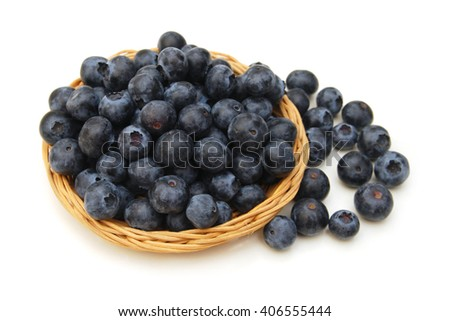 composition from a fresh bow blueberry in basket on the white isolated background  - stock photo