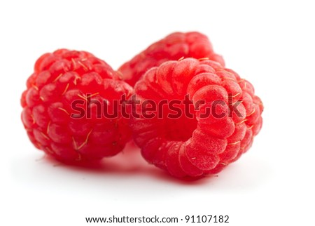 composition from a raspberry on the white isolated background - stock photo