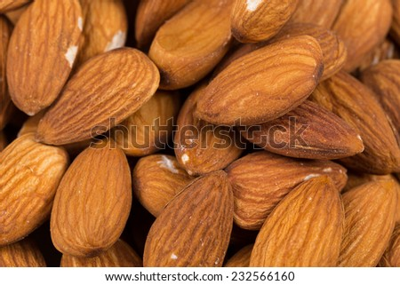 Composition from almond nuts background - macro shot