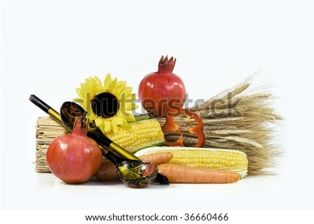 Composition from beautiful ripe apomegranate of ears wheat and vegetables - stock photo