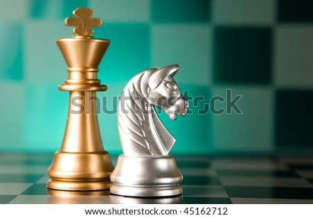 Composition from chessmen on a color background - stock photo