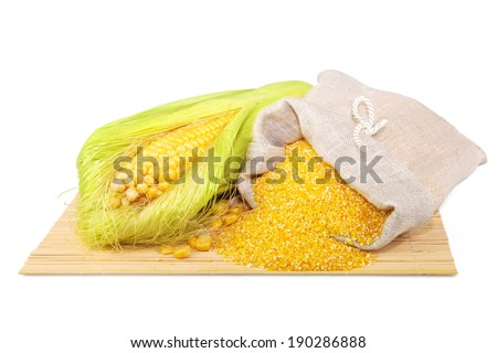 Composition from corn and maize flour in flax sack on the mat isolated on white background - stock photo