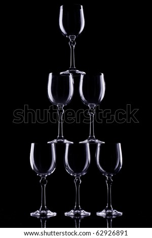 Composition from crystal glasses for wine on a black background