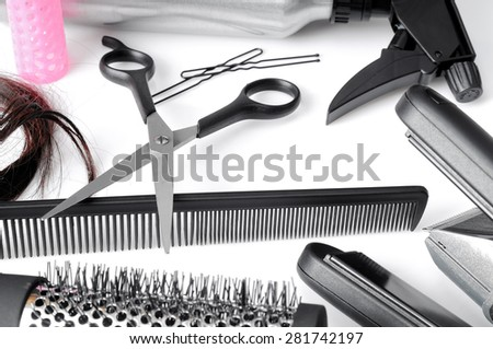 composition hairdressing tools on a white table and white background isolated top view