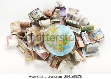Composition made with the globe on Africa side laid on world banknotes - stock photo