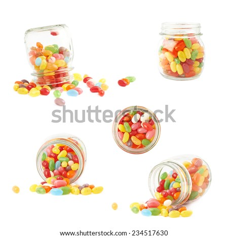 Composition of a glass jar and multiple colorful jelly bean candies, isolated over the white background, set of multiple foreshortenings - stock photo