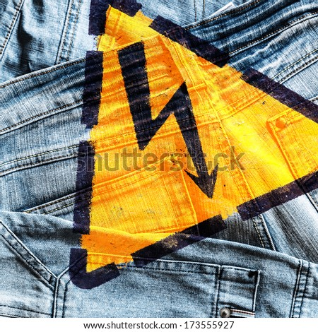 composition of a hazard warning sign on a jeans background