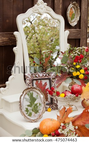 composition of autumn fruits and flowers on royal furniture