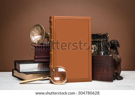 Composition of book and decor in vintage style