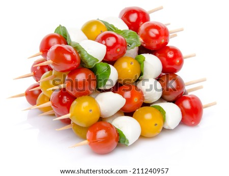Composition of cherry tomatoes and mozzarella on skewers, isolated on white