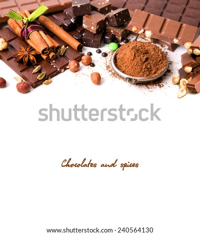 Composition of chocolate bar, cocoa and spices, isolated on white - stock photo