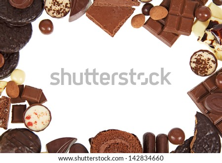 Composition of chocolate sweets closeup, isolated on white