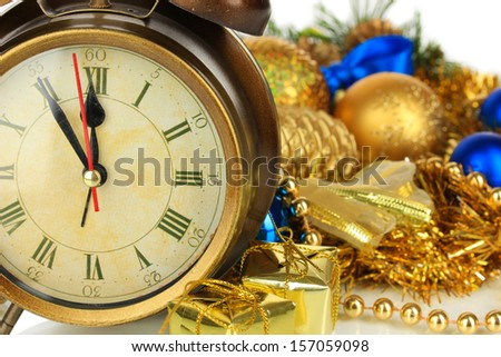 Composition of clock and christmas decorations close-up