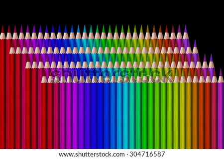 composition  of colored pencils on black background