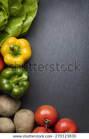 Composition of colorful mixed vegetables isolated on a grey stone background. - stock photo