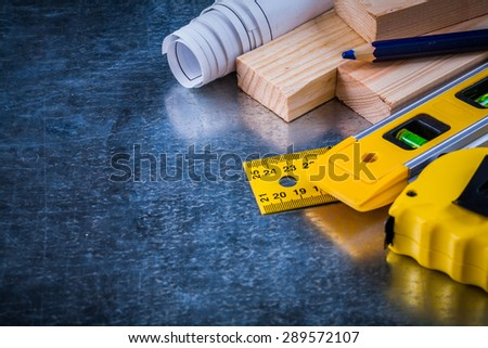 Composition of construction working tools on metallic scratched background architecture and building concept.