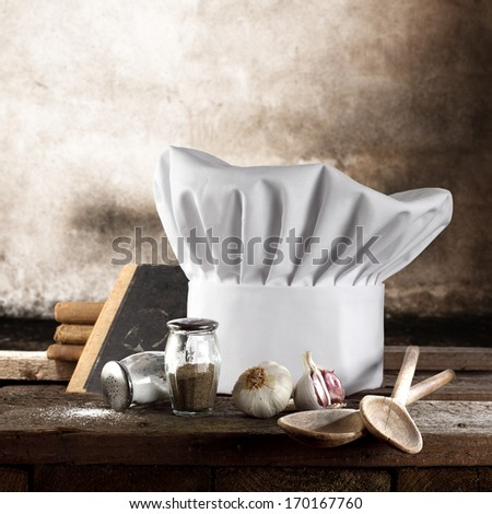 composition of cook hat and book