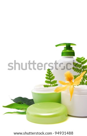 Composition of cosmetic products with flower on white background