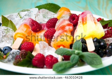Composition of delicious ice cream, fruits and ice cubes