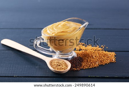 Composition of different kinds of mustard on color wooden background - stock photo