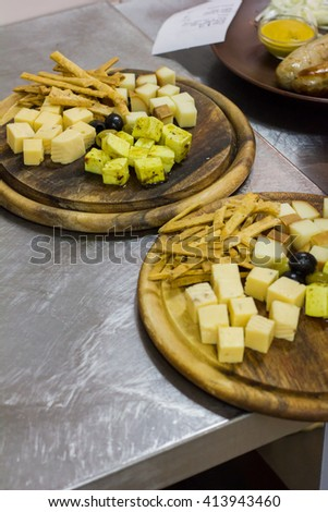 composition of different type of cheese on wooden board - stock photo
