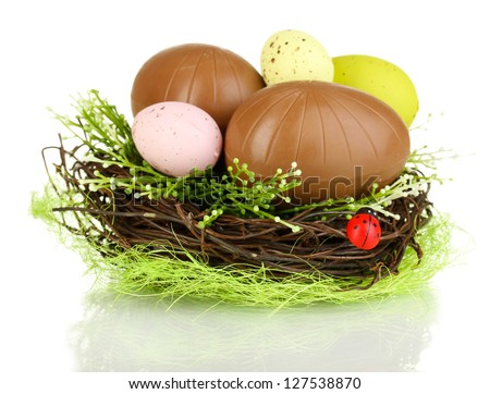 Composition of Easter and chocolate eggs in nest isolated on white - stock photo