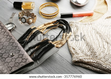Composition of elegant woman's fashion look on wooden background, close up - stock photo