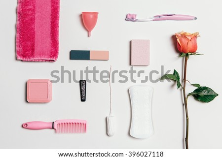 Composition of feminine intimate hygiene set over white background. View from above. - stock photo