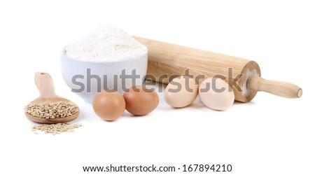 Composition of flour and eggs. Isolated on a white background.