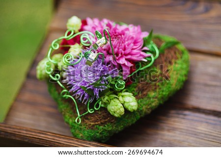 Composition of flowers in heart shape as wedding decor element - stock photo