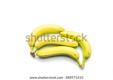 Composition of four fresh bananas isolated on white background. - stock photo