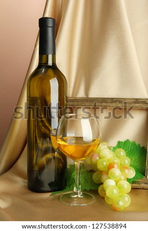 composition of frame,wine and grapes on bright background - stock photo