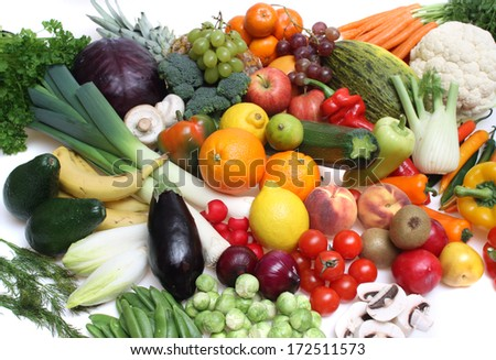 Composition of fruits and vegetables against a white isolated background
